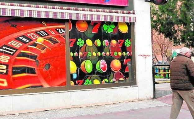 A citizen walks past a gambling hall located in Murcia, in a file image.