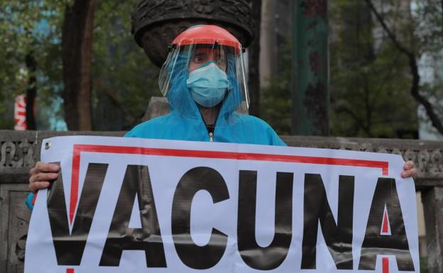 A doctor protests in Mexico City over the shortage of vaccines