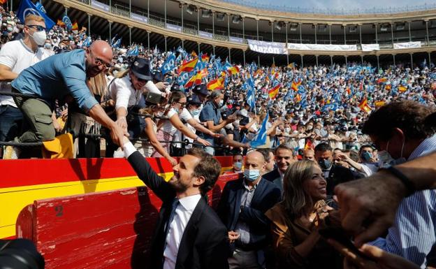 The president of the PP, Pablo Casado, greets the militants upon their arrival at the Plaza de Toros de Valencia